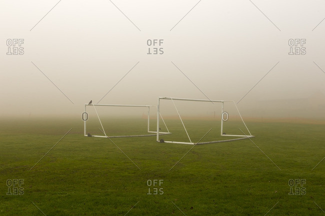 Soccer goal posts in mist, England