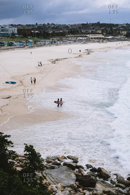 Sydney, Australia - November 14, 2016: Surfers on Bondi Beach