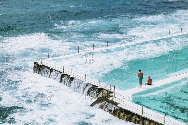 People watching waves on Bondi Beach