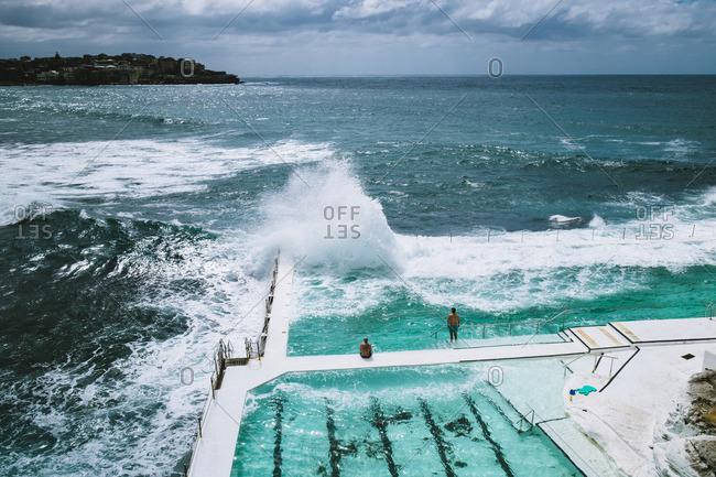 Waves crashing on ocean pool, Sydney, Australia