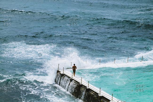 Person at a seaside pool, Sydney, Australia