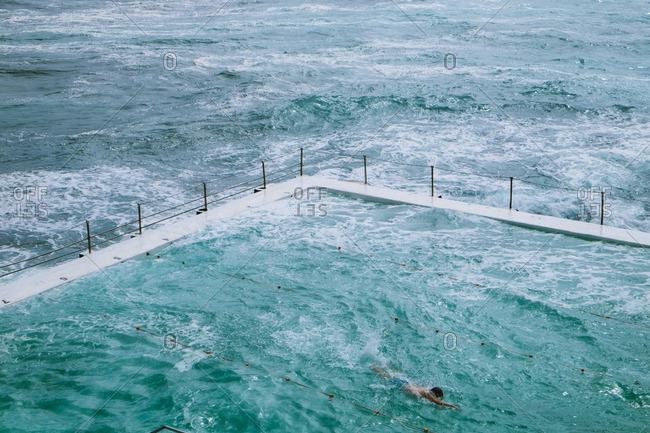 Swimmer at seaside pool, Sydney, Australia