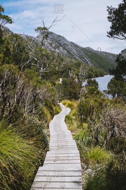 Path through hills near water