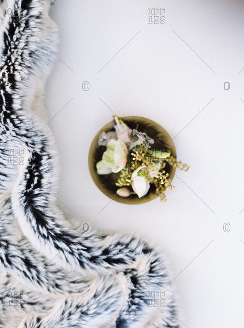Overhead view of floral arrangement by a furry cloth