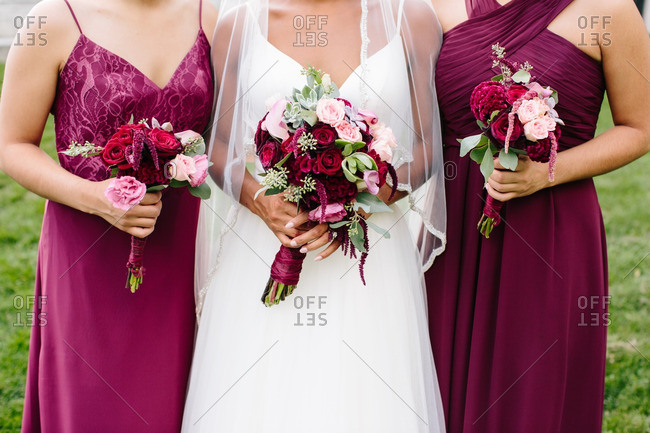 Bride standing with two bridesmaids