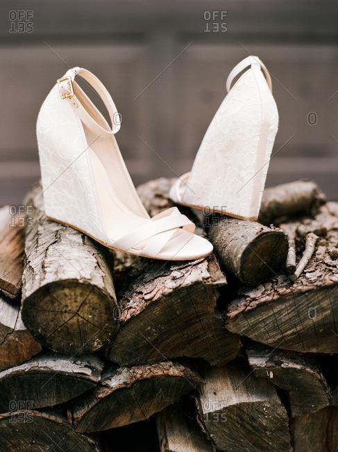 White wedge heels on chopped firewood