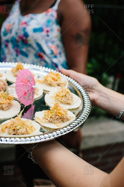 Woman serving appetizers at a wedding