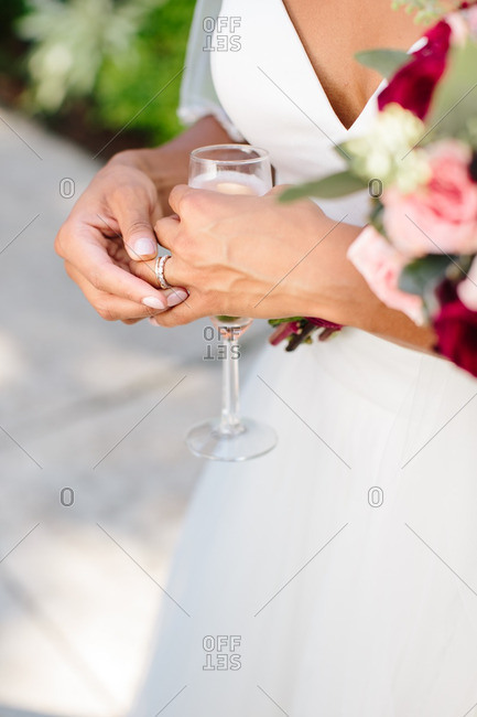 Bride drinking champagne and fiddling with her rings