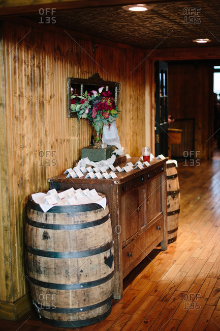 Antique cabinet and barrels with wedding seating cards