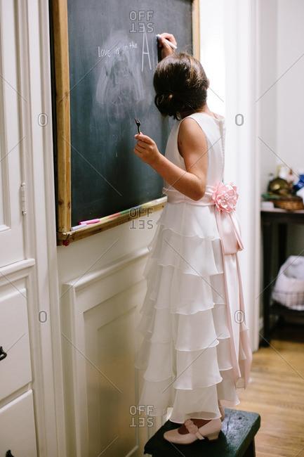 Flower girl writing on a chalkboard