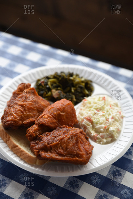 Fried chicken with coleslaw and greens