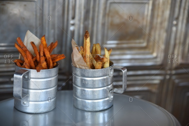 French fries served in metal dishes