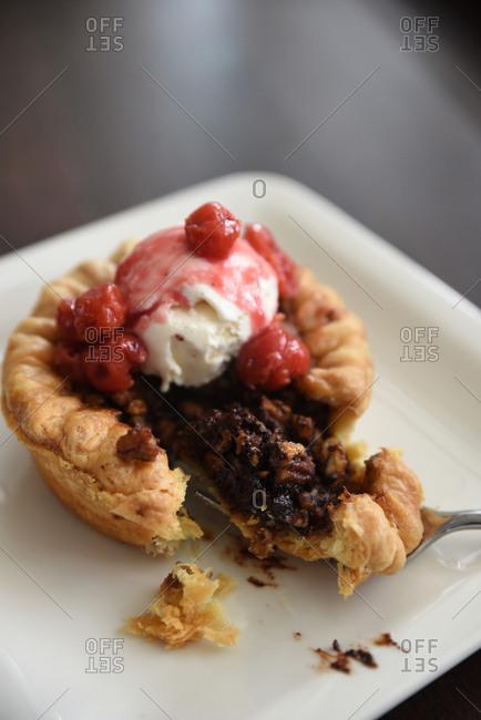Mini pie topped with ice cream