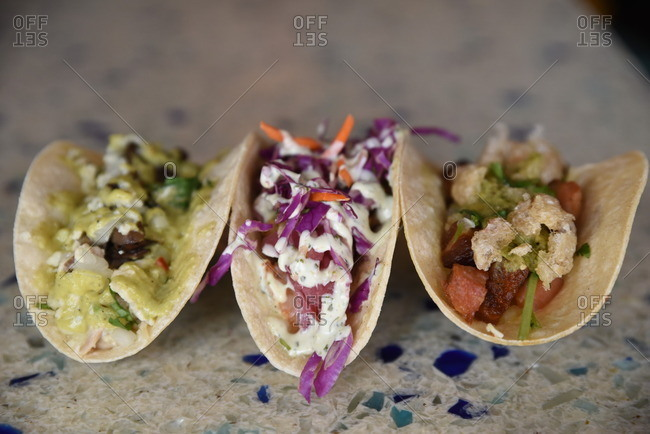 Three tacos served in a restaurant