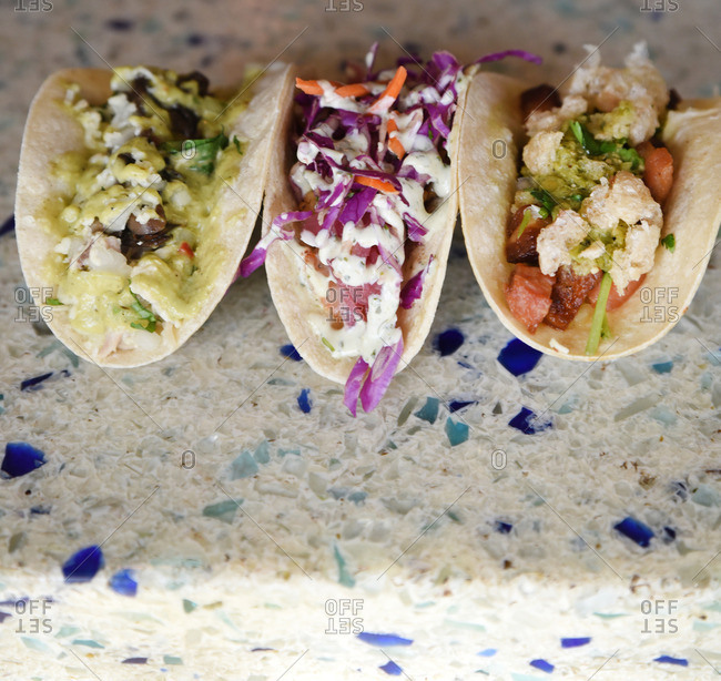 Close up of three tacos served in a restaurant
