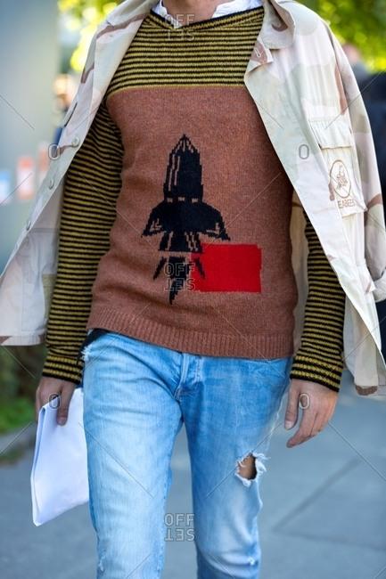 February 2, 2017: Stylish man wearing rocket ship sweater