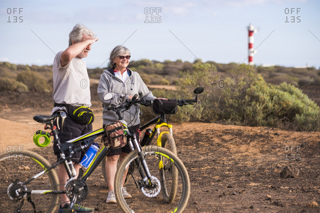 Senior couple on a mountain bike trip in desert