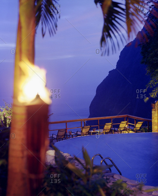 View of Gros Piton mountain at dusk from the swimming pool at Ladera Resort, Soufriere, St. Lucia.