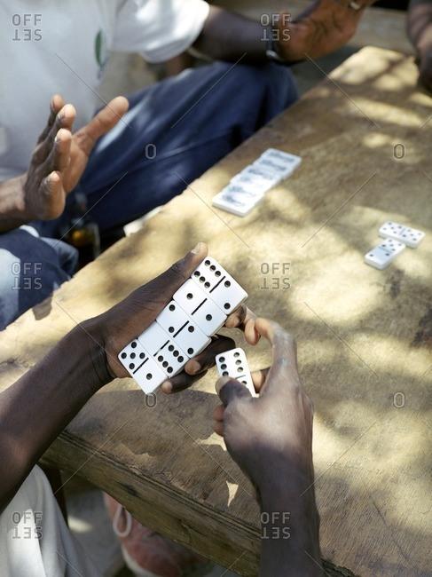 Local men play dominoes on Cas En Bas beach. Cas En Bas, St. Lucia, W.I.