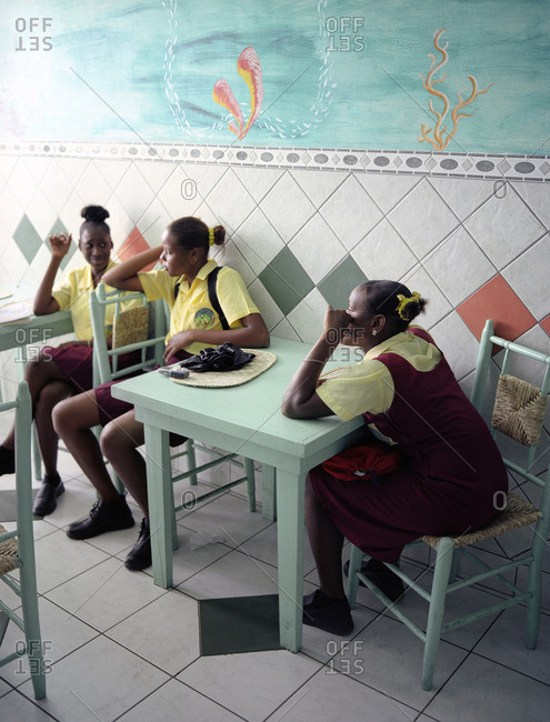 Local students hang out in an ice cream parlour in Soufriere. St. Lucia.