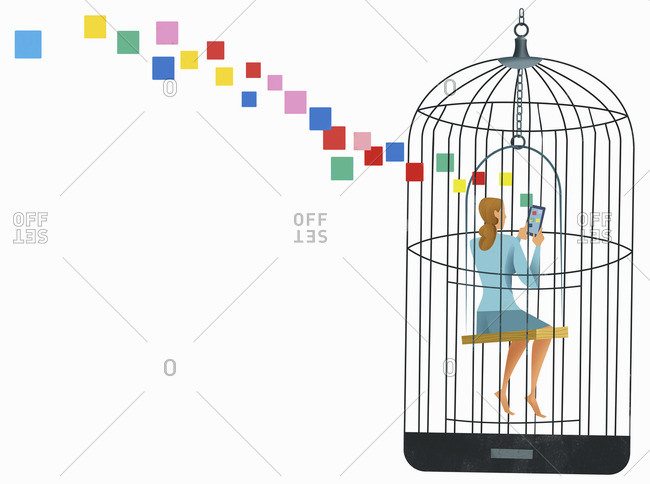 Woman using mobile device inside birdcage