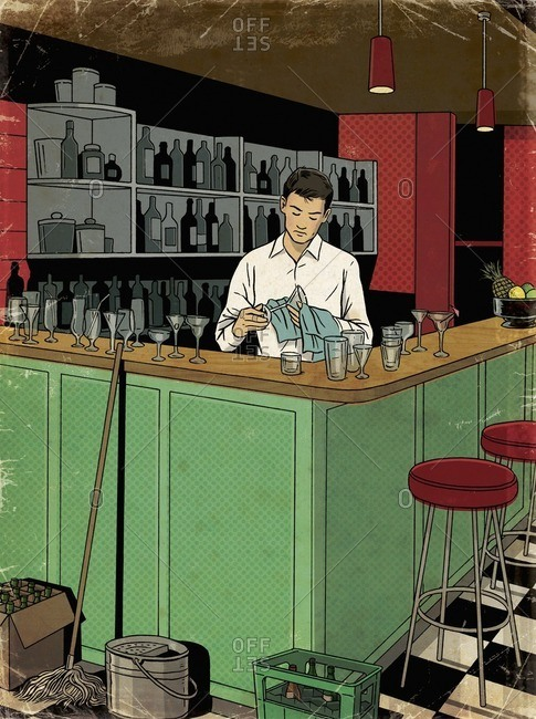 Barman cleaning glasses after closing time