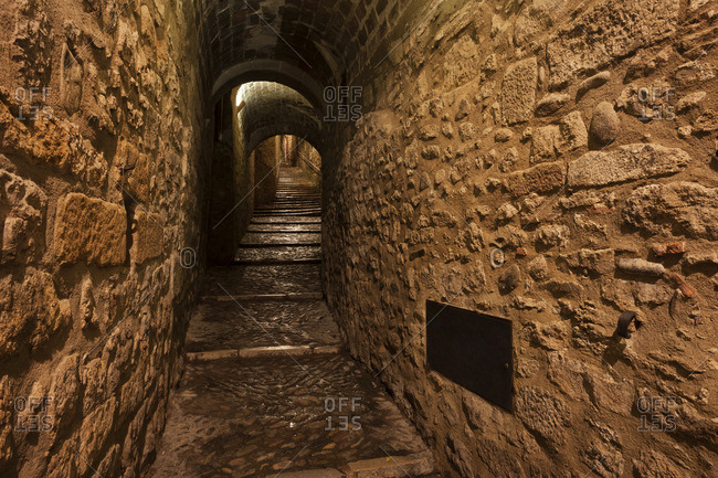 Spain- Girona- narrow passageway  in Barri Vell at night