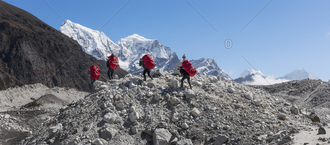 Nepal- Himalaya- Khumbu- Everest region- Porters on Ngozumpa glacier