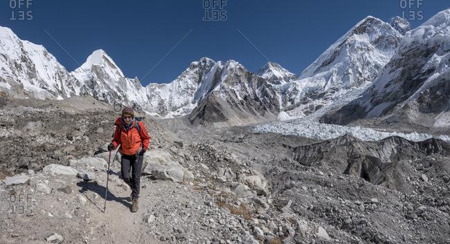 Nepal- Himalaya- Khumbu- Everest region- woman at Everest base camp