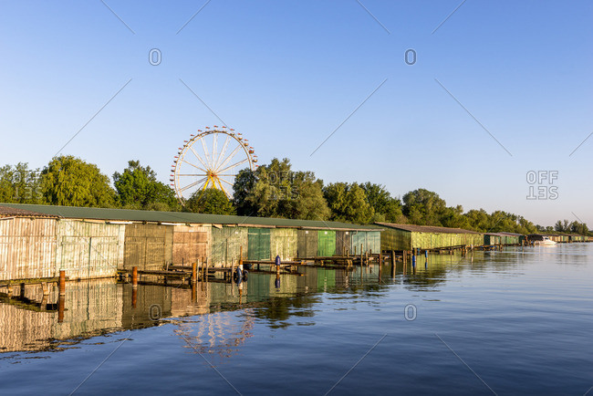 Germany- Rechlin- view to boathouses with big wheel in the background