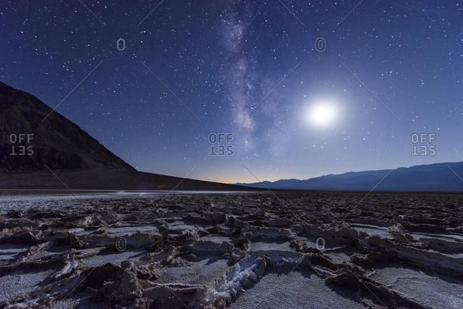 USA- California- Death Valley- Milky way and the moon over Badwater Basin