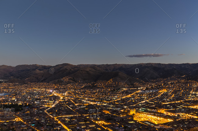 Peru- Andes- Cusco- cityscape as seen from Cristo Blanco Statue at sunset