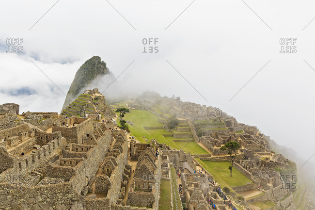 Peru- Andes- Urubamba Valley- Machu Picchu with mountain Huayna Picchu in fog and clouds