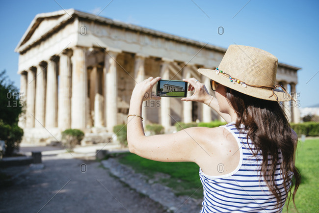 Greece- Athens- woman taking a cell phone pictire of the Hephaisteion in the Agora
