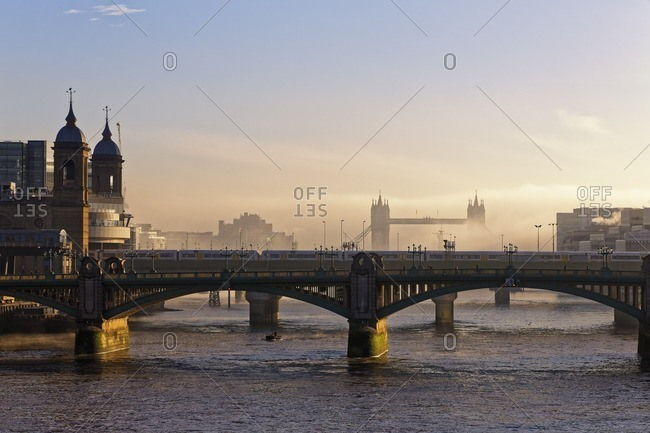 UK- London- Cannon Street Railway Bridge and Tower Bridge in haze