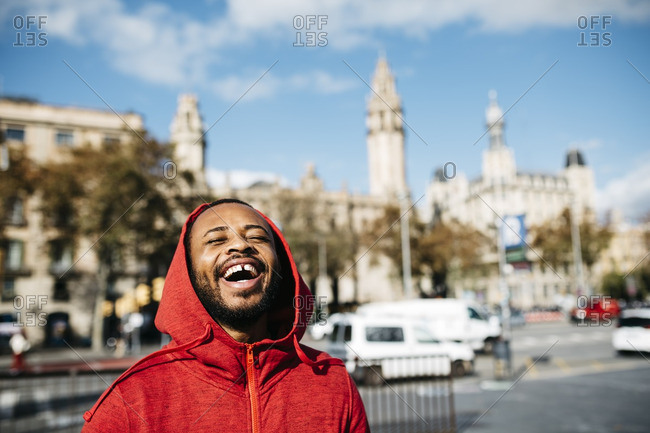 Laughing young man in the city