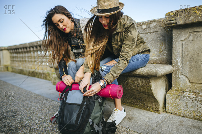 Two young women on a trip having a break