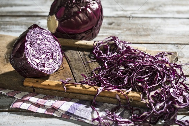 Whole and grated red cabbage with grater