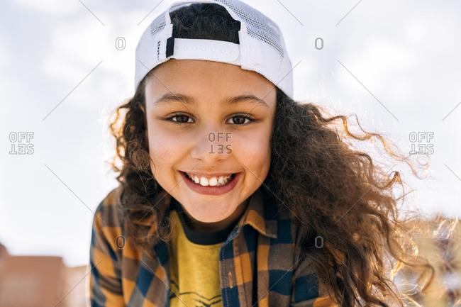 Portrait of happy girl wearing baseball cap