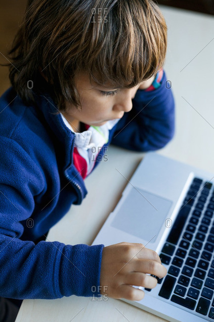 Little boy using laptop