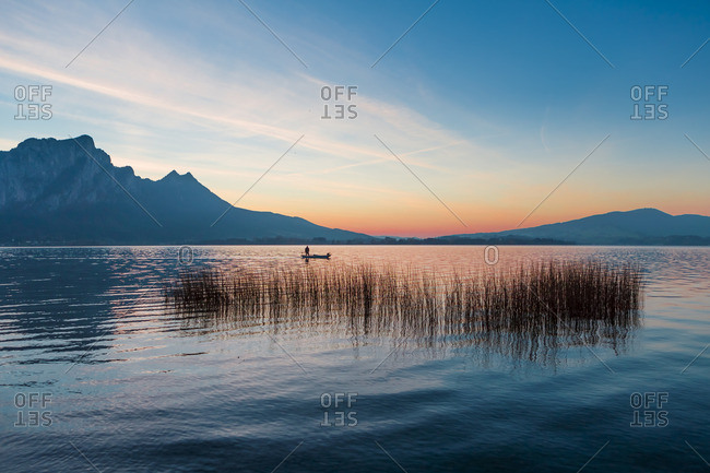 Austria- Mondsee- fishing boat on Lake Mondsee at dusk