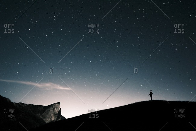 Austria- Mondsee- silhouette of woman standing under starry sky
