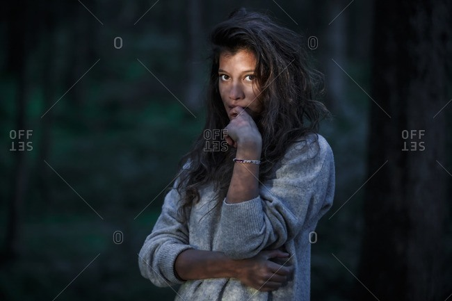 Portrait of young woman in the woods