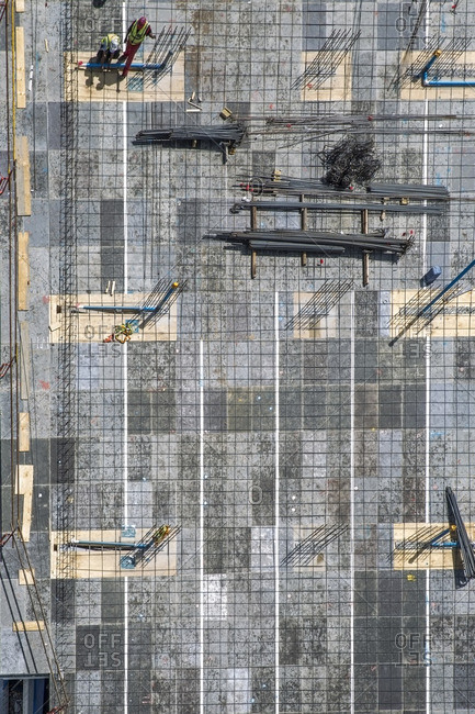 Two workers on construction site- top view