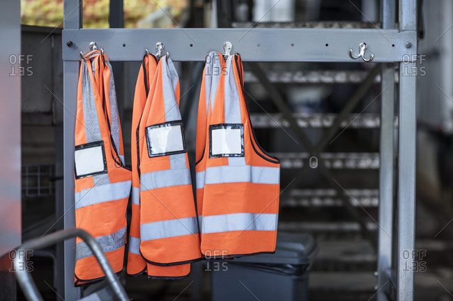 Three safety vests in factory