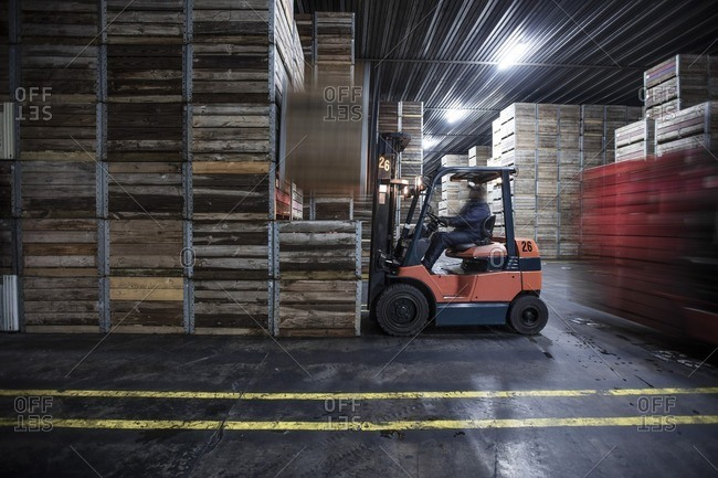 Man on forklift in factory hall