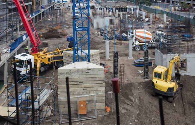 Concrete pump and other machinery on construction site