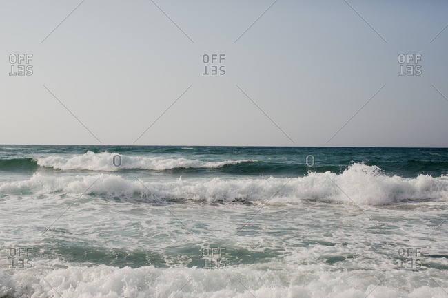 Ocean waves and clear sky