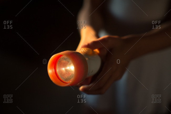 Close up of girl's hand holding electric torch