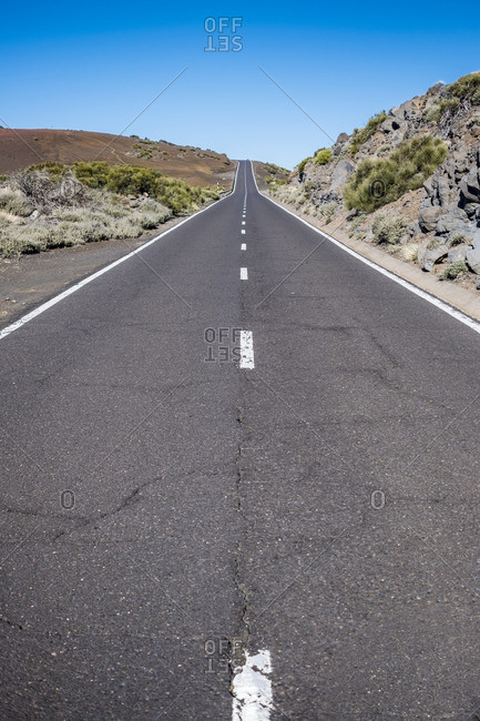 Open road through the desert landscape of Teide National Park